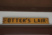 Otters-Lair-Sign